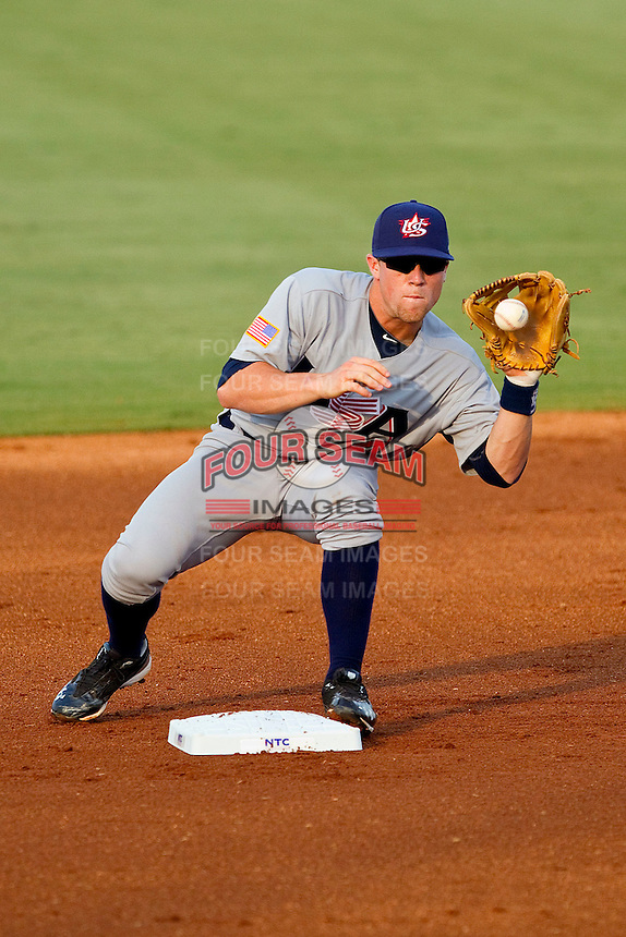 Nolan Fontana #4 (Florida) of the USA Baseball Collegiate National Team fields a throw at second base against the USA 18u National Team at the USA Baseball National Training Center on July 2, 2011 in Cary, North Carolina.  The College National Team defeated the 18u team 8-1.  Brian Westerholt / Four Seam Images