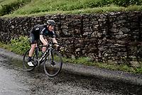Soren Kragh Andersen (DEN/DSM) descending the Col du Pré (HC/1748m) towards the Barrage de Roselend in, yet again, grim conditions.<br /> <br /> Stage 9 from Cluses to Tignes (145km)<br /> 108th Tour de France 2021 (2.UWT)<br /> <br /> ©kramon
