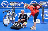 17 JUL 2011 - HAMBURG, GER - Rachel Klamer (NED) (left) talks with Dutch team mate Lisa Mensink (NED) in transition before the start of the women's Hamburg round of triathlon's ITU World Championship Series (PHOTO (C) NIGEL FARROW)