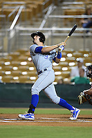 Peoria Javelinas infielder Hunter Dozier (9) hits a home run during an Arizona Fall League game against the Glendale Desert Dogs on October 13, 2014 at Camelback Ranch in Phoenix, Arizona.  The game ended in a tie, 2-2.  (Mike Janes/Four Seam Images)