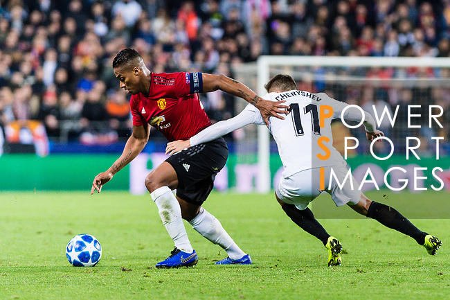 Antonio Valencia of Manchester United (L) fights for the ball with Denis Cheryshev of Valencia CF (R) during the UEFA Champions League 2018-19 match between Valencia CF and Manchester United at Estadio de Mestalla on December 12 2018 in Valencia, Spain. Photo by Maria Jose Segovia Carmona / Power Sport Images