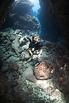 A photographer explores a dive site called Yap Caverns, Yap, Micronesia, Pacific Ocean (MR)