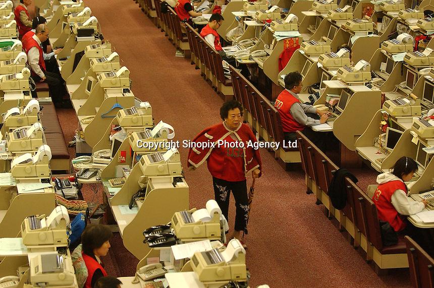 Traders at the Hong Kong Stock Exchange..