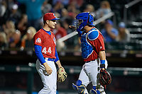 Buffalo Bisons pitcher Ty Tice (44) and catcher Michael De La Cruz (55) celebrate closing out an International League game against the Norfolk Tides on June 21, 2019 at Sahlen Field in Buffalo, New York.  Buffalo defeated Norfolk 1-0, the second game of a doubleheader.  (Mike Janes/Four Seam Images)