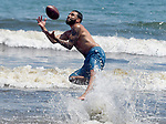 LYNN July 5: Aaron Cornejo, takes a pass from friend Frankie Rivera, as the two Springfield man where enjoying the day at the beach in Lynn, Sunday, July 5,  2020, in Lynn. (Jim Michaud / MediaNews Group/Boston Herald)