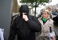 Pictured: Robert Riley (L) arriving at Swansea Magistrates Court (WOMAN ON THE RIGHT IS A JOURNALIST). Thursday 08 May 2014<br />