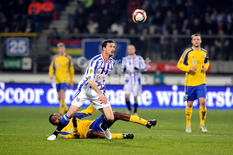 voetbal sc heerenveen - fc ventspils europa leaque seizoen 2009-2010 16-12-2009  gerald sibon met jean paul ndeki