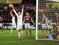 Pictured: Angel Rangel celebrating the equaliser scored by team mate Bafetimbi Gomis of Swansea Saturday 10 January 2015<br /> Re: Barclays Premier League, Swansea City FC v West Ham United at the Liberty Stadium, south Wales, UK