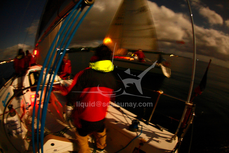 """I have been kindly invited by Jean Luc Esplaas onboard his Archambault 40 """"41 Sud Electropac"""" for the 320 nautical miles bi-annual classic """"Beneteau Lagoon Cup Noumea (New Caledonia) Port Vila (Vanuatu) Race 2009"""" for the local it's simply called the Port Vila race..It was perfect bare foot sailing conditions with a 28 degrees Celsius water temperature, a reasonably smooth and without hiccups reach tack in a 25 knots trade wind and a magnificent full moon for the ambiance exactly as advertised with a very close finish to get all the ingredients in the same basket. .First a multihull """"McMoggy"""" skipper Denis Planchon arrived on Sunday night after a 34h and 38 mins race, the first monohull a Dufour 44 """"internautic 6"""" skipper Thierry Causer arrived on Monday early morning after a 41h and 3 mins race followed by a trio in a pure dawn match racing in the Efate Bay in Port Vila Vanuatu, an Archambault 40 """"Lagoon Ozone"""" skipper Olivier Decouzon in 42 h 52 mins followed by an our dearest Archambault 40 """"41 Sud Electropac"""" skipper Jean-Luc Esplaas in 42 h 54 mins and 4 s and a Young Eleven """"Radical Concept"""" skipper Philippe Mazard in 42 h 54 mins and 50 s...I told you it was a close finish after 320 nautical miles. .All results can be found on: http://cnc.navitrac.fr/stat.php.23 yachts participated in this year's event. Jean Luc Esplaas and his Archambault 40 """"41 Sud Electropac"""" did this race in preparation for the upcoming 65th Rolex Sydney Hobart Yacht Race..Vanuatu, formerly the Anglo-French condominium of the New Hebrides is largely an untouched paradise in the South Pacific. Port Vila is the seat of government and the main business centre of the island group. .I have been kindly invited by Jean Luc Esplaas onboard his Archambault 40 """"41 Sud Electropac"""" for the 320 nautical miles bi-annual classic """"Beneteau Lagoon Cup Noumea (New Caledonia) Port Vila (Vanuatu) Race 2009"""" for the local it's simply called the Port Vila race..It was perfect bare foot sailing conditions with"""