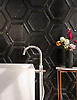 Coliseum, a stone waterjet mosaic, shown in honed Nero Marquina and Venetian honed Marquina, is part of the Altimetry® collection for New Ravenna.<br /> Tub courtesy of Badeloft<br /> www.badeloftusa.com