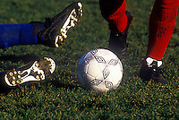 Feet of competing soccer players.