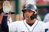 Lakeland Flying Tigers Isaac Paredes (3) high fives teammates in the dugout after hitting a home run in the bottom of the third inning during a game against the Tampa Tarpons on April 5, 2018 at Publix Field at Joker Marchant Stadium in Lakeland, Florida.  Tampa defeated Lakeland 4-2.  (Mike Janes/Four Seam Images)