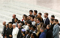 Pope Francis poses with a group of faithful at the end of his weekly general audience in the Paul VI hall at the Vatican, January 22, 2020.<br />