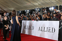 "LOS ANGELES - NOV 9:  Marion Cotillard, Photographers at the ""Allied"" Fan Screening at the Village Theater on November 9, 2016 in Westwood, CA"