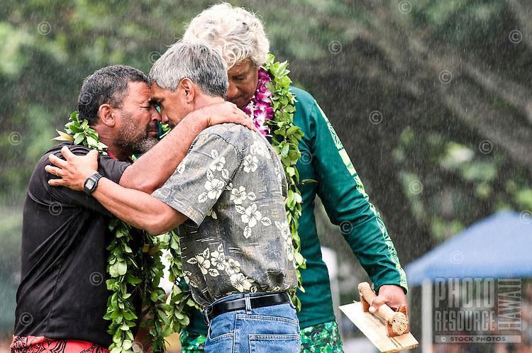 Jack Thatcher, navigator of voyaging canoe, Te Aurere (New Zealand), left, is honored by Nainoa Thompson, navigator of voyaging canoe Hokule'a (Hawai'i), right. Tua Pittman, Cook Islands navigator, appears in background... Arrival of Pacific voyaging canoes, Kualoa Regional Park, Hakipu'u, O'ahu, on June 25, 2011.