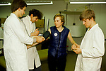 NHS first year junior doctor training.  Practicing on a fellow student. St Georges South London 1980s UK