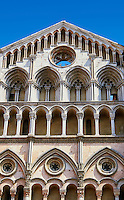 Late Gothic sculptures and architectural additions to the facade of the 12th century Romanesque Ferrara Duomo, Italy