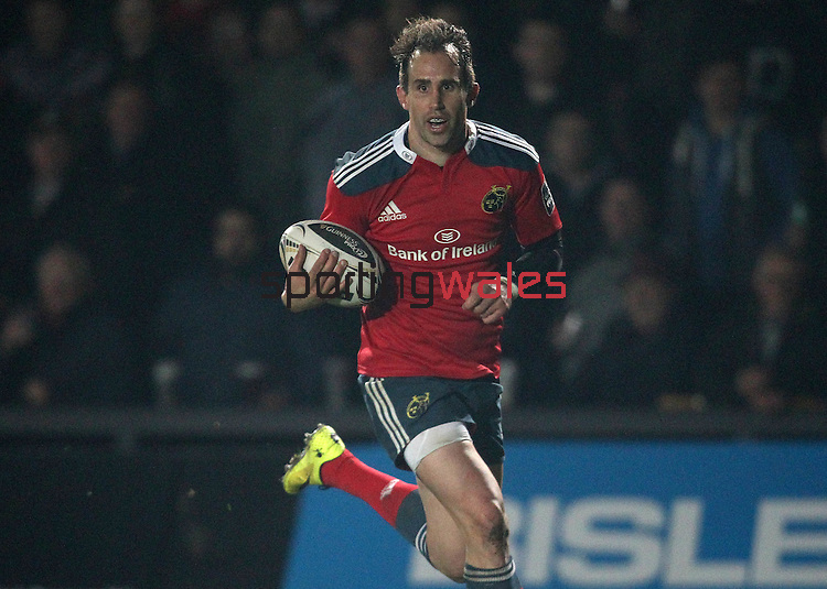 Outside centre Andrew Smith of Munster Rugby runs through the Dragons defence to score a try.<br /> <br /> Guinness Pro 12<br /> Newport Gwent Dragons v Munster Rugby<br /> Rodney Parade<br /> 21.11.14<br /> ©Steve Pope-SPORTINGWALES
