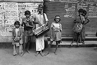 Children beg and perform for money on the streets of Calcutta, India - Child labor as seen around the world between 1979 and 1980 – Photographer Jean Pierre Laffont, touched by the suffering of child workers, chronicled their plight in 12 countries over the course of one year.  Laffont was awarded The World Press Award and Madeline Ross Award among many others for his work.