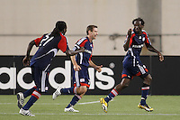 New England Revolution forward Kheli Dube (11) celebrates scoring with midfielder Steve Ralston (14) and midfielder Shalrie Joseph (21). The New England Revolution defeated Santos Laguna 1-0 during a Group B match of the 2008 North American SuperLiga at Gillette Stadium in Foxborough, Massachusetts, on July 13, 2008.