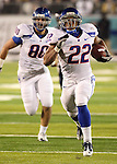 Boise State Broncos running back Doug Martin runs for a touchdown with teammate Kyle Efaw during their NCAA college football game against Nevada Saturday night, Nov. 26, 2010, in Reno, Nev. (AP Photo/Cathleen Allison)