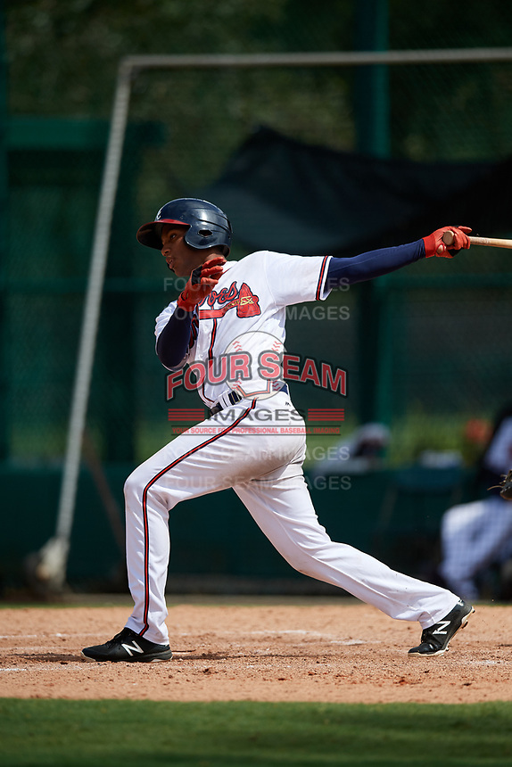 GCL Braves right fielder Joel Reyes (25) follows through on a swing during the second game of a doubleheader against the GCL Yankees West on July 30, 2018 at Champion Stadium in Kissimmee, Florida.  GCL Braves defeated GCL Yankees West 5-4.  (Mike Janes/Four Seam Images)