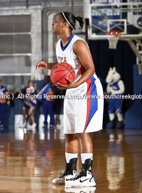 Texas - Arlington Mavericks guard Tamara Simmons (20) looks for a open player in the game between the UTA Mavericks and the  Nicholls State University Colonels  held at the University of Texas in Arlington's Texas Hall in Arlington, Texas. UTA defeats Nicholls 69 to 62