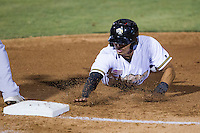 San Antonio Missions outfielder Rico Noel (17) dives back to first base during the Texas League baseball game against the Midland RockHounds on July 13, 2013 at Nelson Wolff Municipal Stadium in San Antonio, Texas. The Missions defeated the Rock Hounds 5-4. (Andrew Woolley/Four Seam Images)