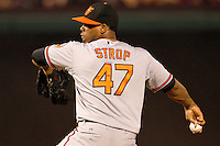 Baltimore Orioles pitcher Pedro Strop #47 delivers during the Major League Baseball game against the Texas Rangers on August 21st, 2012 at the Rangers Ballpark in Arlington, Texas. The Orioles defeated the Rangers 5-3. (Andrew Woolley/Four Seam Images).