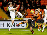 23rd September 2021;  Tannadice Park, Dundee, Scotland: Scottish League Cup football, Dundee United versus Hibernian: Lewis Stevenson of Hibernian with a high boot on Kieran Freeman of Dundee United compete for possession of the ball