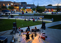 Members of the local band Dandelion Heart perform Thursday, Oct. 15, 2020, as a part of the LIVE! at Turnbow Park concert series in Walter Turnbow Park at Shiloh Square in downtown Springdale. The free concert was presented by Engel & Völkers NWA, Downtown Springdale and Springdale Parks and Recreation. The next concert in the series features Pura Coco and Neako 6 p.m. Thursday with concerts planned for each of the next three Thursdays. Visit nwaonline.com/201016Daily/ for today's photo gallery. <br /> (NWA Democrat-Gazette/Andy Shupe)