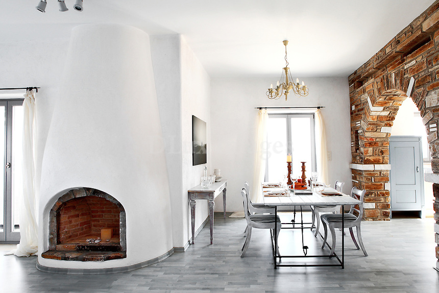 contemporary dining area with fireplace