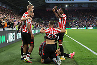 Brentford players celebrate their second goal scored by Vitaly Janelt during Brentford vs Liverpool, Premier League Football at the Brentford Community Stadium on 25th September 2021