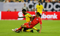 NASHVILLE, TENN - JULY 03: Reggie Cannon #14, Junior Flemmings #12 during a 2019 CONCACAF Gold Cup Semifinal match between the United States and Jamaica at Nissan Stadium on July 03, 2019 in Nashville, Tennessee.