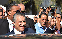 3 October 2019, Tunisia, Tunis: Tunisian presidential candidate Nabil Karoui greets supporters after casting his vote outside a polling station during the second round of the Tunisian presidential between presidential candidates Kais Saied and Nabil Karoui.