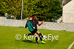 Park FC Thomas Dereki puts in a challenge on  Luice Casey of Fenit Samphires in the U16 Soccer league