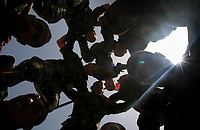 """Palestinian security forces demonstrate their skills at a graduation ceremony after completing their training in Gaza May 7, 2007.""""photo by fady Adwan"""""""