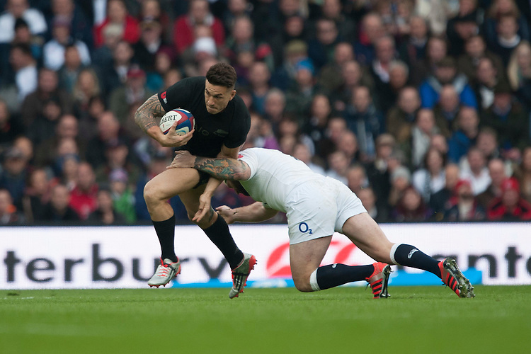 Sonny Bill Williams of New Zealand is tackled by Joe Marler of England during the QBE International match between England and New Zealand at Twickenham Stadium on Saturday 8th November 2014 (Photo by Rob Munro)