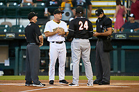Bradenton Marauders coach Jim Horner (16) during the lineup exchange with coach Frank Moore (24), umpires Austin Nelson (left) and Kaleb Martin before a game against the Jupiter Hammerheads on June 26, 2021 at LECOM Park in Bradenton, Florida.  (Mike Janes/Four Seam Images)