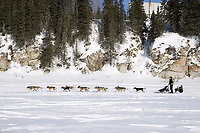 Jeff King runs down Fish River after leaving White Mtn a second time 2006 Iditarod Alaska Winter