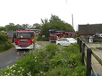 BNPS.co.uk (01202 558833)<br /> Pic: AnthonyOliverMBE/BNPS<br /> <br /> Almost £2,000 has been raised to help a family whose historic thatched cottage home has been destroyed by a huge blaze.<br /> <br /> The family of four watched helplessly as the top half of the idyllic, Grade II listed property went up in flames.<br /> <br /> The £900,000 cottage is in the village of Pamphill, near Wimborne, Dorset, and is part of the National Trust-owned Kingston Lacy estate.<br /> Credit/Provider: