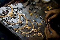 Artisanal gold smiths in Kolkata (Calcutta) make gold necklaces for weddings.