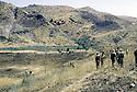 Irak 1985 Dans les zones libérées, région de Lolan, peshmergas pres de villages rasés  Iraq 1985  In liberated areas, Lolan district, peshmergas on ruins of villages destroyed by the Iraqi army