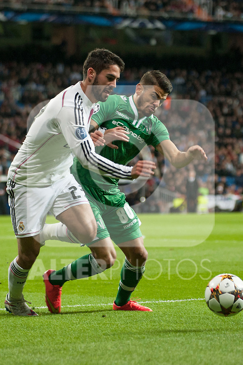 Isco of Real Madrid and Paula Junior of Ludogorets during Champions League match between Real Madrid and Ludogorets at Santiago Bernabeu Stadium in Madrid, Spain. December 09, 2014. (ALTERPHOTOS/Luis Fernandez)