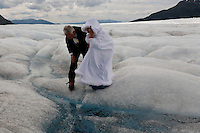 Karl Newkirk and Ann (Ricky) Arnsby - Glacier Wedding.Diane Pearson has started arranging weddings for people who want to get married on a glacier.  The couple arrived from a cruise ship in a stretch limo, put on their crampons and flew by helicopter onto the Mendenhall Glacier.  There they said their vows, drank champagne, ate caviar and wedding cake and then danced to their favorite song on top of the ice.  .Karl, a native Ohioan, packed his bags and came to Sarasota, Florida shortly after retirement in early 2002.  He spotted Ricky across the room at a crowded restaurant.  He knew she was the.one. Ricky is British but had been in Sarasota for 18 years, running a business. Almost two years later, things had progressed and they decided to be married in a way that would be memorable and special. North Star employees and a photographer and videographer, Diane and her assistant Paul, joined in and recorded the private celebration that lasted about an hour and a half.