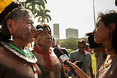 Kayapo Chiefs Raoni Metuktire and Megaron Txucarramae talk to an International television reporter at the People's Summit, United Nations Conference on Sustainable Development, Rio de Janeiro, Brazil, 2012.