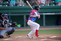 """Shortstop Nick Sogard (11) of the Greenville Drive during a game against the Brooklyn Cyclones on Saturday, May 15, 2021, at Fluor Field at the West End in Greenville, South Carolina. Drive players were wearing jerseys for the """"Ranas de Rio de Greenville"""" (Greenville River Frogs), as part of Minor League Baseball's """"Copa de la Diversion."""" The catcher is Hayden Senger (24). (Tom Priddy/Four Seam Images)"""
