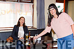 MAura Healy Rae drops a drink to Margaret Galvin after reopening the family bar in Kilgarvan on Friday evening
