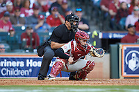 Arkansas Razorbacks catcher Casey Opitz (12) frames a pitch as home plate umpire Michael Banks looks on during the game against the Oklahoma Sooners in game two of the 2020 Shriners Hospitals for Children College Classic at Minute Maid Park on February 28, 2020 in Houston, Texas. The Sooners defeated the Razorbacks 6-3. (Brian Westerholt/Four Seam Images)
