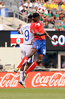 Dennis Marshall (20) of Costa Rica and Jerry Bengtson (9) of Honduras during a quarterfinal match of the 2011 CONCACAF Gold Cup at the New Meadowlands Stadium in East Rutherford, NJ, on June 18, 2011.